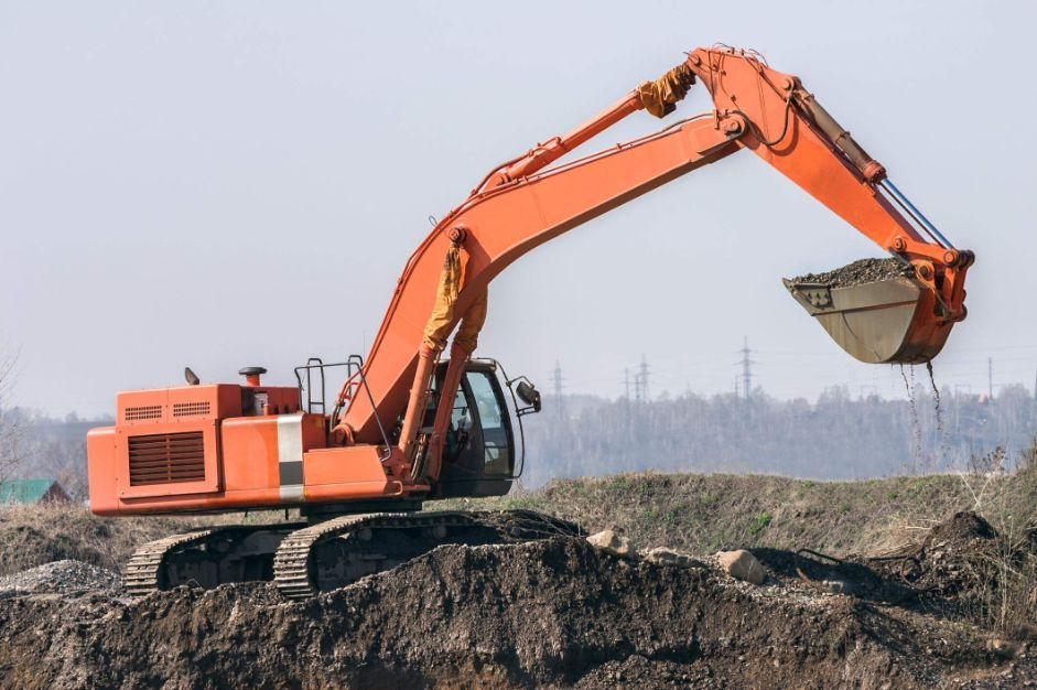 Large excavator preparing an industrial site