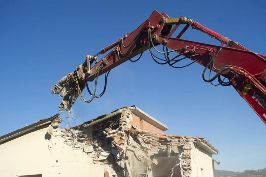 Cutter machine working on a residential demolition site